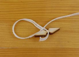 Loom dressing cord